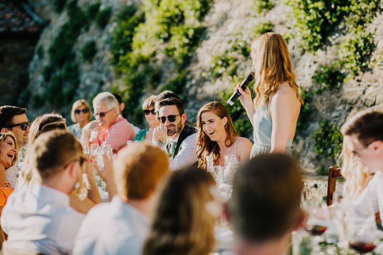 Guests enjoy the wedding speeches from bridal party with bridesmaid dresses in mint green