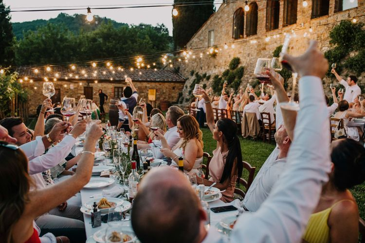 Guests raise a toast to the happy couple