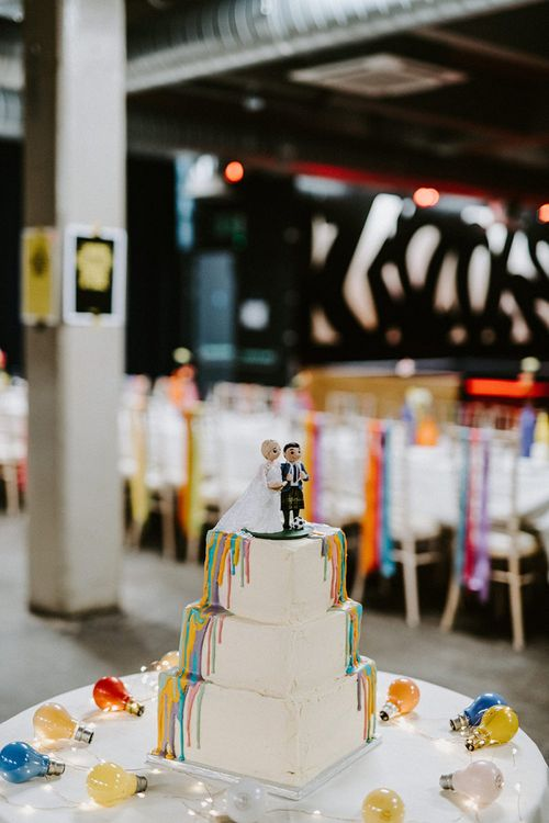 Square Wedding Cake with Colourful Drip Icing and Miniature Bride and Groom Cake Topper