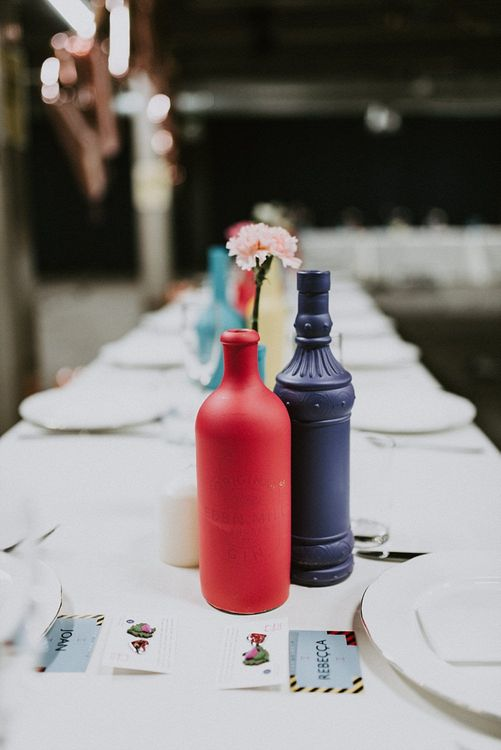 Colourful Spray Painted Bottles as Table Centrepieces