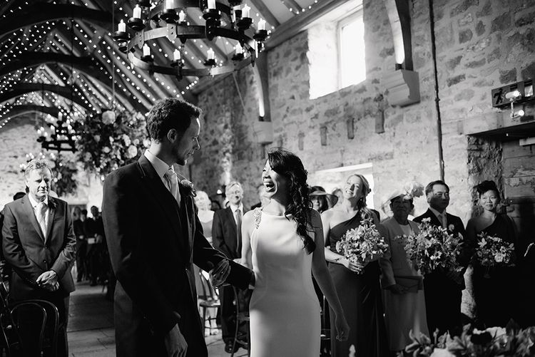 Wedding Ceremony | Bride in Racerback Pronovias Wedding Dress | Groom in Navy Blue Morning Suit | Healey Barn Countryside Wedding with Wild Flowers and Bride in Pronovias | Georgina Harrison Photography