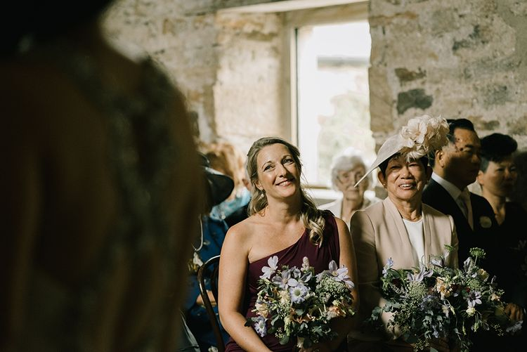 Bridesmaid in Burgundy Phase Eight Dress | Mother of the Bride in Blush Pink Jacket and Skirt from L.K.Bennett | Healey Barn Countryside Wedding with Wild Flowers and Bride in Pronovias | Georgina Harrison Photography