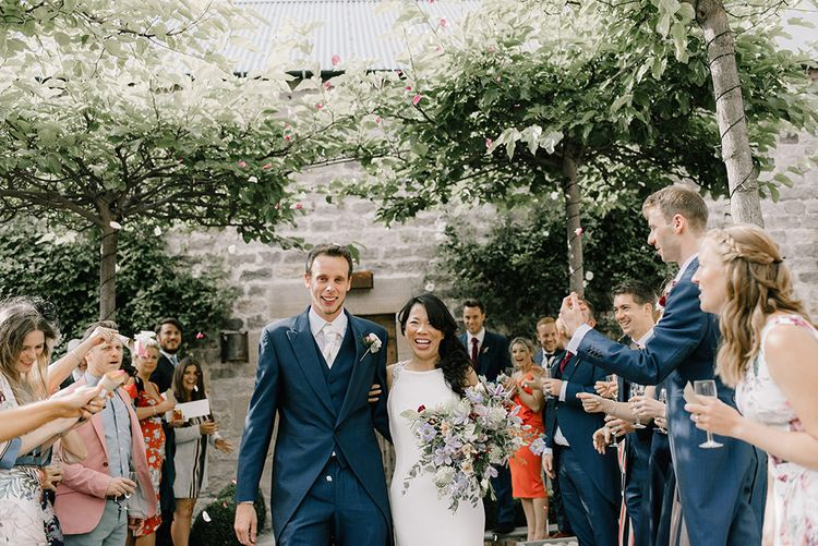 Just Married | Bride in Racerback Pronovias Wedding Dress | Groom in Navy Blue Morning Suit | Pastel Bridal Bouquet | Healey Barn Countryside Wedding with Wild Flowers and Bride in Pronovias | Georgina Harrison Photography