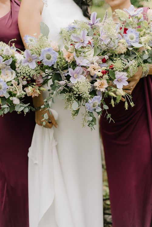 Bridal Party Bouquet of Pastel Wild Flowers | Bridal Morning Preparations | Bridesmaids in Burgundy Phase Eight Dresses | Bride in Racerback Pronovias Wedding Dress | Healey Barn Countryside Wedding with Wild Flowers and Bride in Pronovias | Georgina Harrison Photography