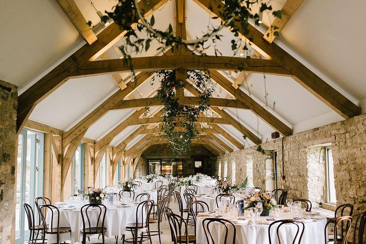 Wedding Reception Decor | Foliage Hoops | Healey Barn Countryside Wedding with Wild Flowers and Bride in Pronovias | Georgina Harrison Photography