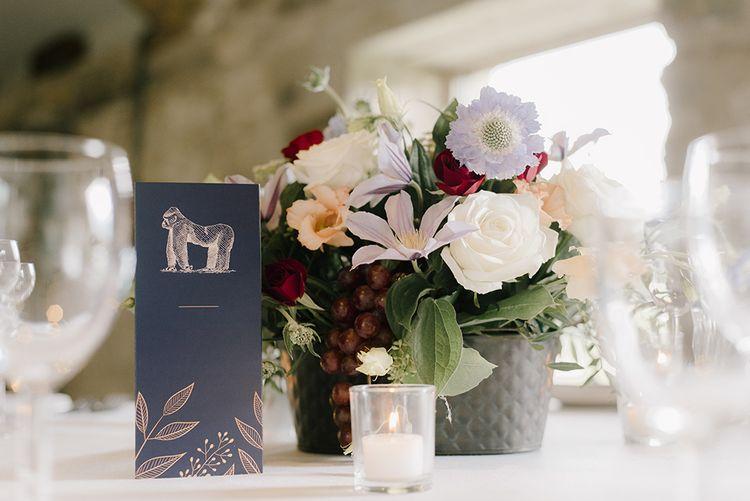 Wedding Reception Decor | Tea Lights | Vase of Pastel Flowers | Healey Barn Countryside Wedding with Wild Flowers and Bride in Pronovias | Georgina Harrison Photography