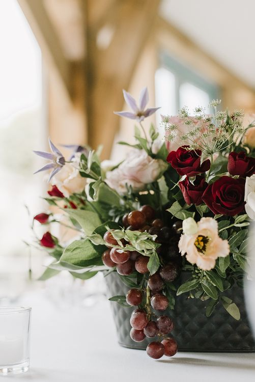 Floral Centrepiece with Grapes | Wedding Flowers |  Bride in Racerback Pronovias Wedding Dress | Healey Barn Countryside Wedding with Wild Flowers and Bride in Pronovias | Georgina Harrison Photography
