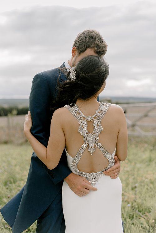 Bride in Embellished  Racerback Pronovias Wedding Dress | Healey Barn Countryside Wedding with Wild Flowers and Bride in Pronovias | Georgina Harrison Photography