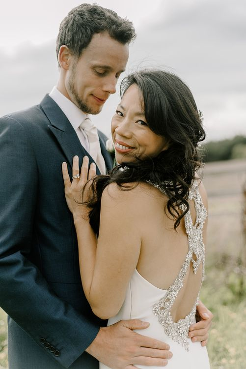Bride in Racerback Pronovias Wedding Dress | Groom in Navy Blue Morning Suit | Healey Barn Countryside Wedding with Wild Flowers and Bride in Pronovias | Georgina Harrison Photography