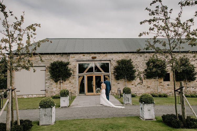 Healey Barn Wedding Venue | Bride in Racerback Pronovias Wedding Dress | Groom in Navy Blue Morning Suit | Healey Barn Countryside Wedding with Wild Flowers and Bride in Pronovias | Georgina Harrison Photography