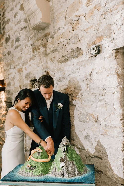 Cutting of Cake | Wedding Cake of Sugar Beach Viceroy Resort in St Lucia | Bride in Racerback Pronovias Wedding Dress | Groom in Navy Blue Morning Suit | Healey Barn Countryside Wedding with Wild Flowers and Bride in Pronovias | Georgina Harrison Photography
