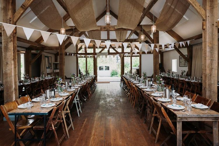 Rustic Barn Wedding Table Set Up With Bunting
