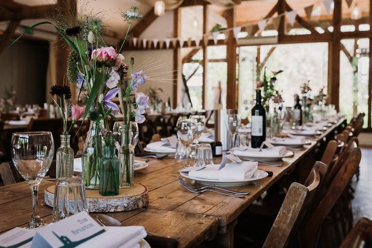 Rustic Barn Wedding Table Set Up With Wild Flowers