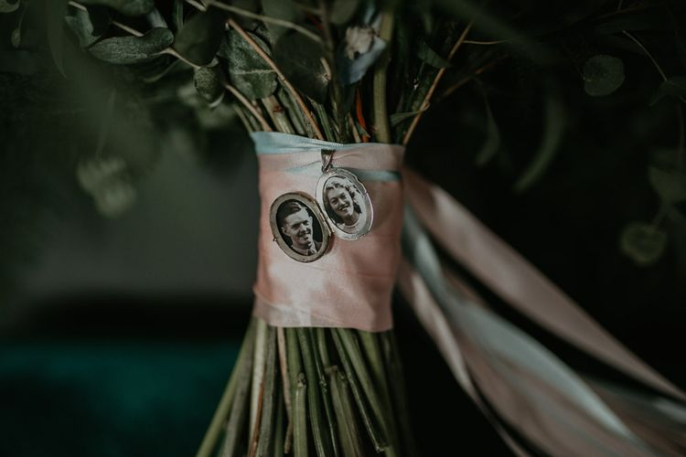 Photographs of relatives on bride's pastel bouquet