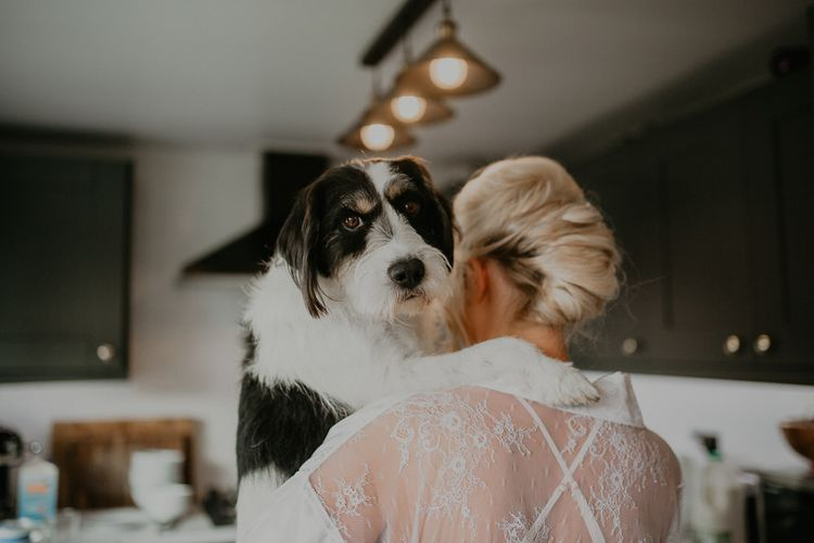 Bride has a cuddle with beloved pet pooch whilst getting ready