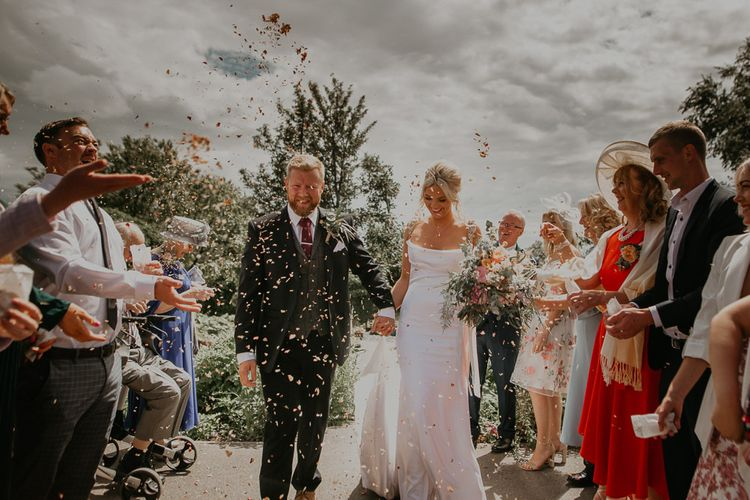 Confetti exit for bride and groom at small wedding