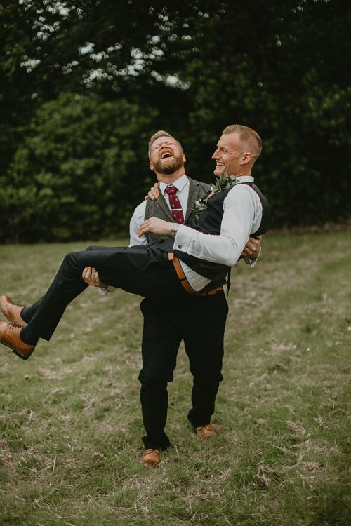 Groom and best man wear waistcoats on wedding day