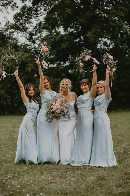 Hoop bouquets for bridesmaids in blue Maids to Measure dresses with bride in embroidered veil