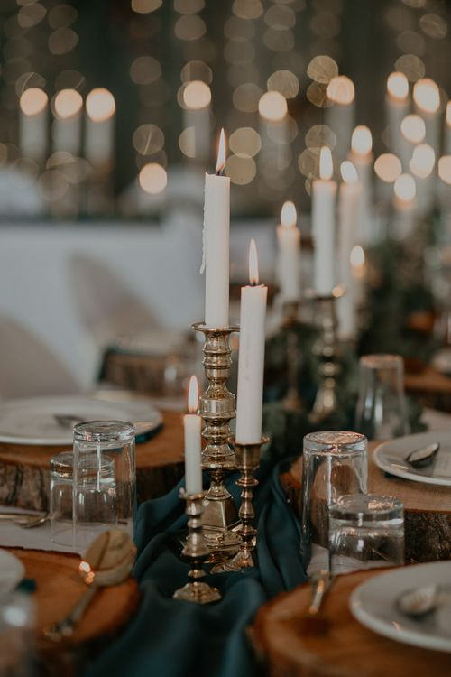 Wedding table decor with candles and gold candle sticks