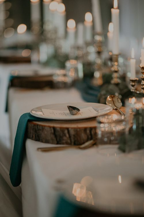 Rustic wedding table decor with tree slices