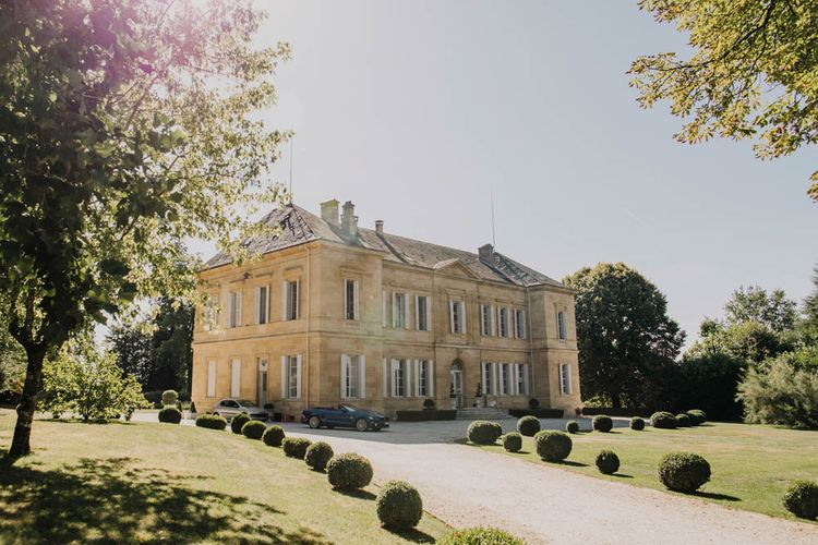 Chateau La Durantie, Dordogne   Outdoor Seating Area and Macaroon Tower at French Chateau Wedding   Lush Imaging