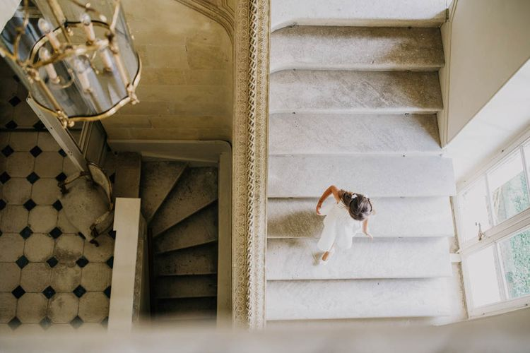 Flower Girl in White Dress on Staircase at Chateau La Durantie, Dordogne   Outdoor Seating Area and Macaroon Tower at French Chateau Wedding   Lush Imaging