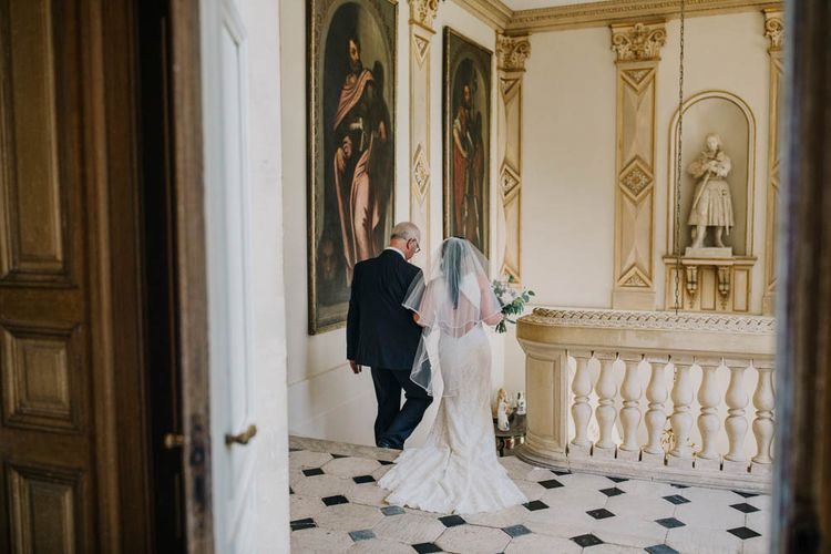Bride in Lace Boat Neck Pronovias Wedding Dress with Keyhole Back and Fishtail Train   Fingertip Length Veil   Bridal Bouquet of Blush and White Flowers with Foliage   Outdoor Seating Area and Macaroon Tower at French Chateau Wedding   Lush Imaging