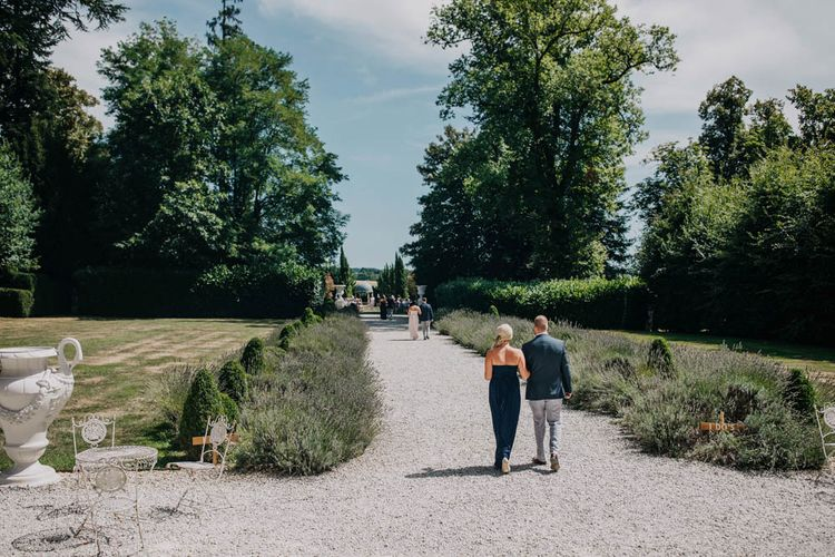 Bridesmaids in Strapless Navy or Pink Dresses from ASOS   Groomsmen in Navy Jackets and Grey Trousers   Arrival of the Bridal Party at Chateau La Durantie, Dordogne   Outdoor Seating Area and Macaroon Tower at French Chateau Wedding   Lush Imaging