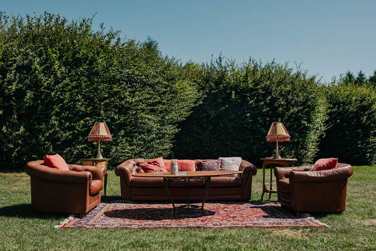 Vintage Sofa   Vintage Armchairs   Rug   Retro Lampshades   Outdoor Seating Area and Macaroon Tower at French Chateau Wedding   Lush Imaging