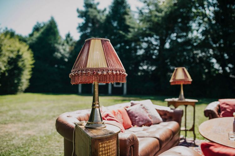 Retro Lampshades   Vintage Sofa   Vintage Armchairs   Rug   Outdoor Seating Area and Macaroon Tower at French Chateau Wedding   Lush Imaging