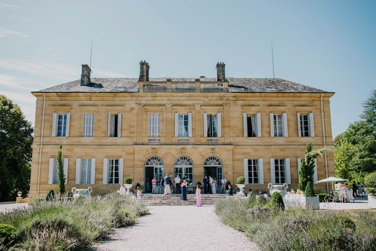 Wedding Reception at Chateau La Durantie, Dordogne   Outdoor Seating Area and Macaroon Tower at French Chateau Wedding   Lush Imaging