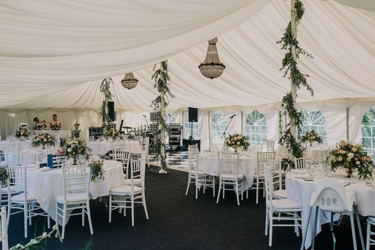 Foliage Garlands Wrapped Around Marquee Poles   Table Centrepieces of Blush and White Flowers with Foliage in Gold Urns   Marquee at Chateau La Durantie, Dordogne   Outdoor Seating Area and Macaroon Tower at French Chateau Wedding   Lush Imaging
