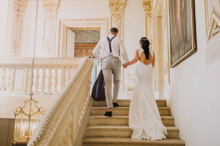 Bride in Lace Boat Neck Pronovias Wedding Dress with Keyhole Back and Fishtail Train   Groom in Navy Jacket, Grey Trousers and White Shirt with Pink Tie from Suit Supply   Chateau La Durantie, Dordogne   Outdoor Seating Area and Macaroon Tower at French Chateau Wedding   Lush Imaging