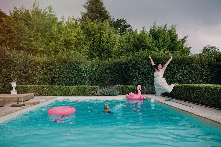 Swimming Pool at Chateau La Durantie, Dordogne   Bridesmaid in Strapless Pink Dress from ASOS   Outdoor Seating Area and Macaroon Tower at French Chateau Wedding   Lush Imaging
