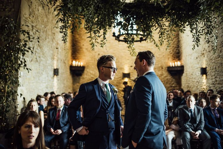 Groom and Best Man at the Altar in Navy Suits with Forest Green Ties