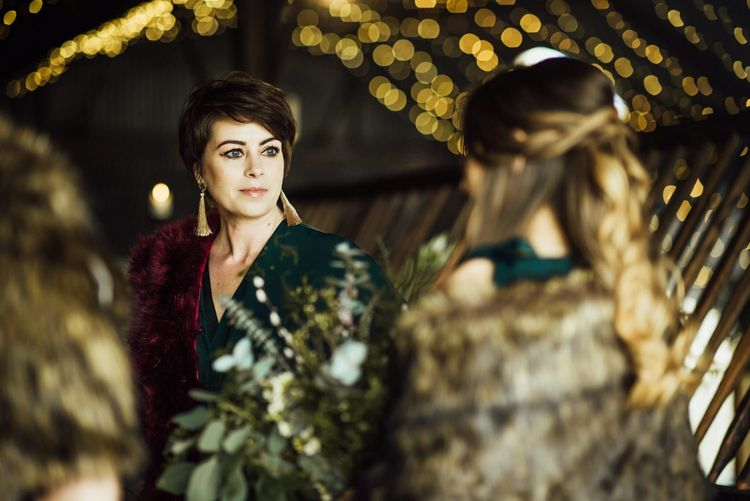 Bridesmaids in Forest Green Outfits with Metallic Gold Accessories