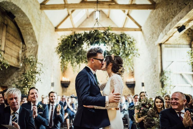 Bride and Groom at Stone Barn Wedding Ceremony Kissing