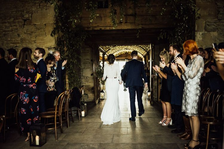 Bride and Groom Exiting Their Stone Barn Wedding Ceremony