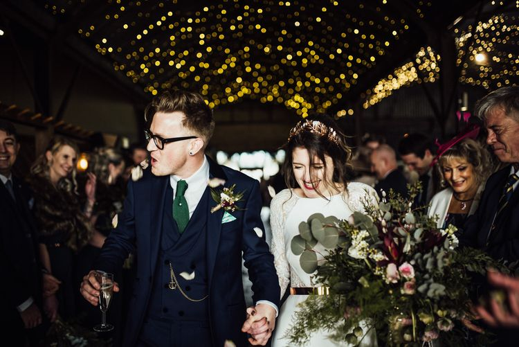 Stylish Bride and Groom Confetti Exit Under Stone Barn Wedding Wedding Venue Fairy Lights