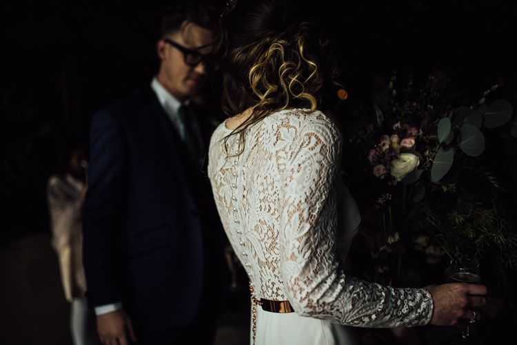 Bride in Lace Back Wedding Dress with Long Sleeves