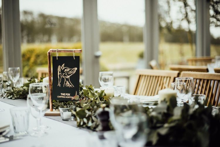 Black & White Table Name Sign Hanging From Copper Frame