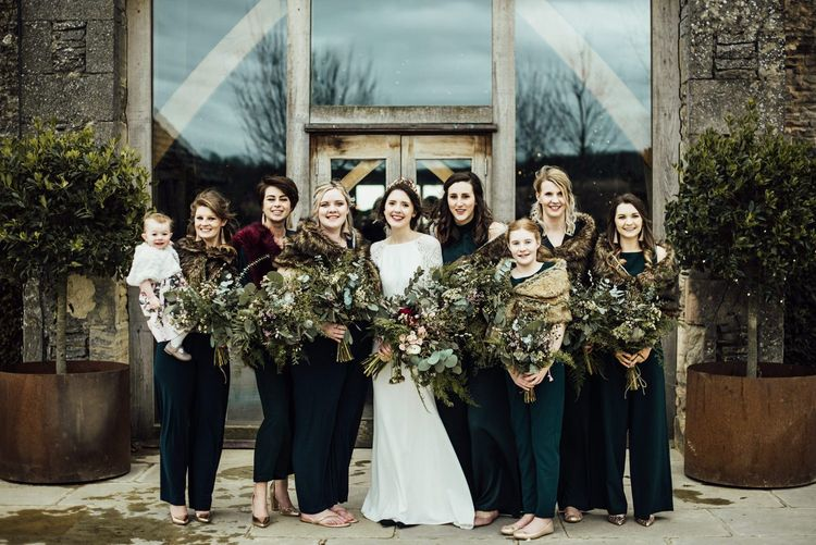 Bridal Party Portrait with Bridesmaids in Forest Green Dresses and Faux Fur Cover Ups