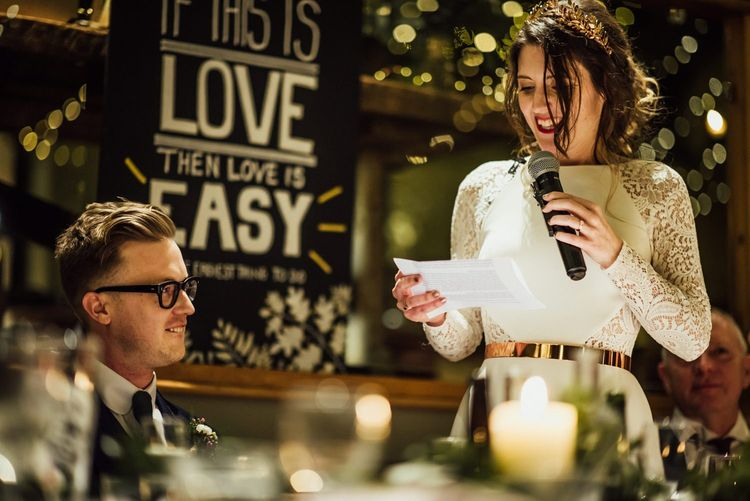 Bride in Wedding Dress with Lace Long Sleeves Giving Her Wedding Speech