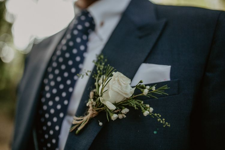 White Rose Buttonhole | Groom in Navy Blue Suit  | Macramé & Dreamcatcher Woodland Wedding at Upthorpe Wood | Camilla Andrea Photography