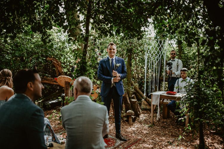 Groom at the Altar in Blue Wedding Suit | Macramé & Dreamcatcher Woodland Wedding at Upthorpe Wood | Camilla Andrea Photography