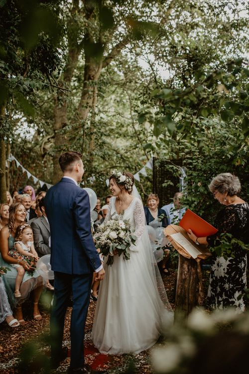 Outdoor Humanist Wedding Ceremony | Boho Bride in Flower Crown & Kula Tsurdui  Wedding Dress | Groom in Navy Blue Suit  | Macramé & Dreamcatcher Woodland Wedding at Upthorpe Wood | Camilla Andrea Photography