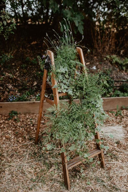 Vintage Step Ladder Covered in Foliage Wedding Decor | Macramé & Dreamcatcher Woodland Wedding at Upthorpe Wood | Camilla Andrea Photography