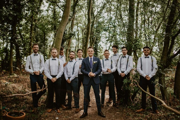 Groomsmen in Bow Tie & Braces | Groom in Navy Blue Suit  | Macramé & Dreamcatcher Woodland Wedding at Upthorpe Wood | Camilla Andrea Photography