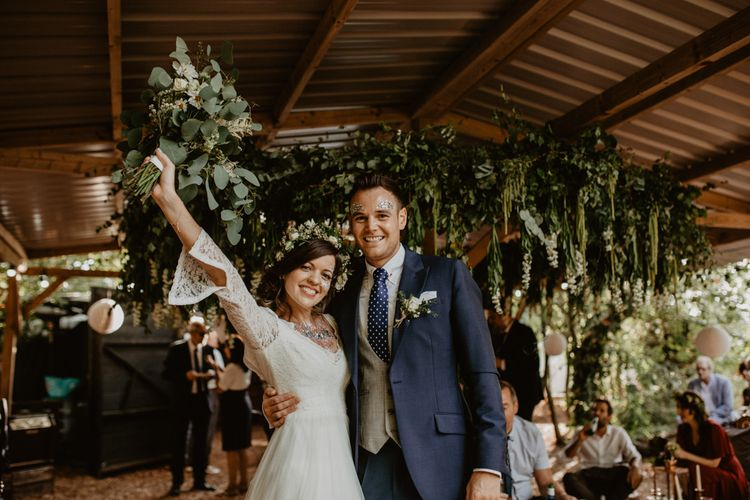 Boho Bride in Flower Crown & Kula Tsurdui  Wedding Dress | Groom in Navy Blue Suit  | Macramé & Dreamcatcher Woodland Wedding at Upthorpe Wood | Camilla Andrea Photography