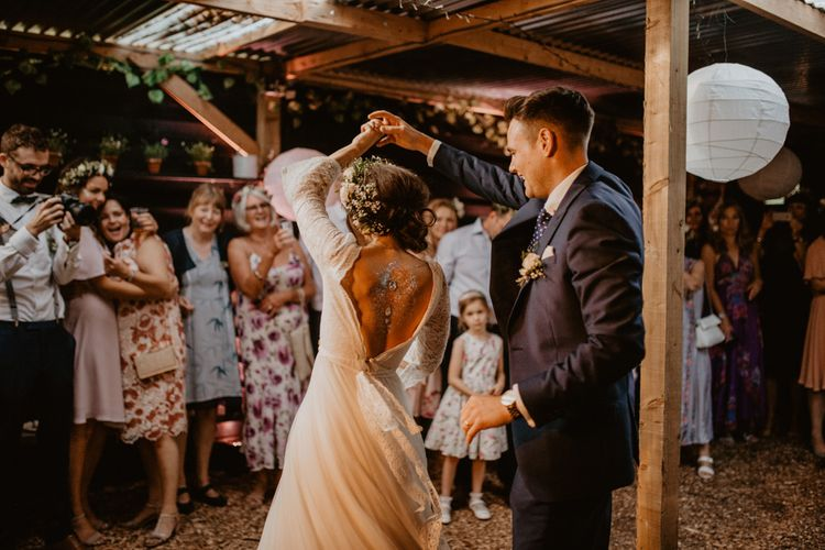 First Dance | Boho Bride in Flower Crown & Kula Tsurdui  Wedding Dress | Groom in Navy Blue Suit  | Macramé & Dreamcatcher Woodland Wedding at Upthorpe Wood | Camilla Andrea Photography